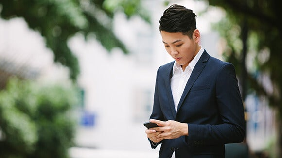 man in a suit texting
