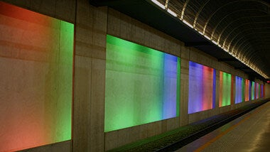 tunnel lit up in rainbow lights image banner for IT jobs